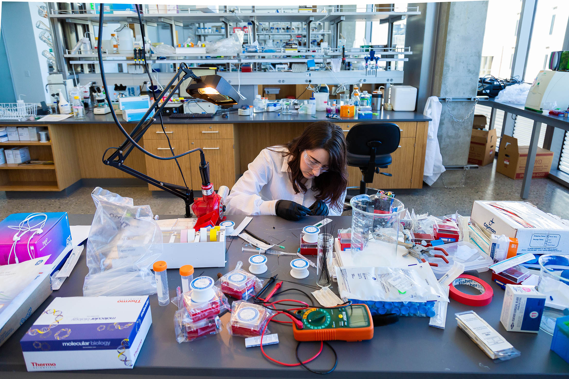 This is a student doing research in a lab.